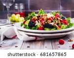 delicious summer salad with mix ... | Shutterstock . vector #681657865