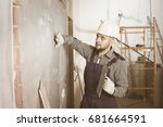 male builder is checking the... | Shutterstock . vector #681664591