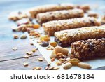 Stock photo healthy bars with nuts seeds and dried fruits on the wooden table with copy space 681678184