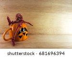 halloween cup with skeleton bone | Shutterstock . vector #681696394