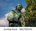 Green Copper Statue In Front O...