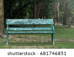 Small photo of A chair in public park. feel lonely. feel single. feel peaceful.