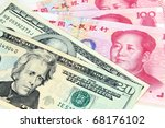 US dollar vs Chinese RMB - tug-of-war of currency depreciation and appreciation - stock photo