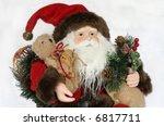 close-up of santa holding toys - stock photo