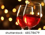 Wineglass with red illuminated defocussed christmas light background - stock photo
