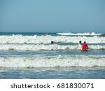Three Kids Catching Waves On A...