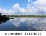 clouds and trees reflected in... | Shutterstock . vector #681878719