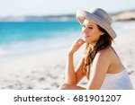 young woman sitting on the beach | Shutterstock . vector #681901207