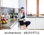 woman in the kitchen. cooking... | Shutterstock . vector #681919711