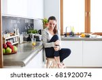 woman in the kitchen. cooking... | Shutterstock . vector #681920074