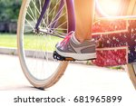 active woman riding bicycle.... | Shutterstock . vector #681965899
