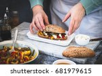 woman preparing whole sandwich... | Shutterstock . vector #681979615