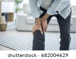 old man suffering from knee pain | Shutterstock . vector #682004629