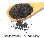 Black Sesame Seeds In Wooden...