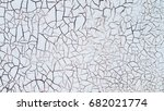 shabby and cracked white paint. | Shutterstock . vector #682021774