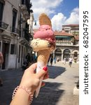 Small photo of Tasty Italian ice cream gelato with strawberry and cookies in waffle cone