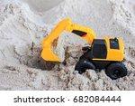 a miniature car on a sand at... | Shutterstock . vector #682084444