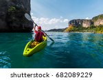 woman paddles kayak in the... | Shutterstock . vector #682089229