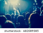 crowd with raised hands at... | Shutterstock . vector #682089385