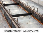 Construction of tramway track with steel rails coating - vibration damping material for noise reduction, in the urban area
