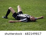 the tired soccer player is... | Shutterstock . vector #682149817
