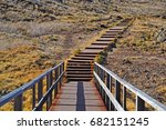 wooden stairs to the beach.... | Shutterstock . vector #682151245