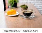 black coffee and orange cake... | Shutterstock . vector #682161634