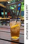 Small photo of rock shandy beverage in a glass with ice and lemon