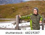 little boy sitting on a wooden... | Shutterstock . vector #68219287