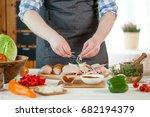 male preparing chicken for... | Shutterstock . vector #682194379