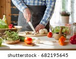 male cooking healthy salad | Shutterstock . vector #682195645