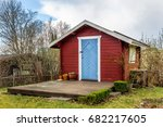 red tiny house or shed at a... | Shutterstock . vector #682217605