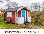 Red Tiny House Or Shed At A...