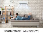 woman lying on sofa using... | Shutterstock . vector #682221094