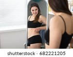 young woman looking at herself... | Shutterstock . vector #682221205