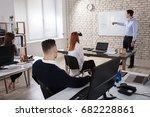 male manger giving presentation ... | Shutterstock . vector #682228861