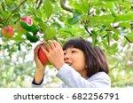 Girls Enjoy Picking Apple