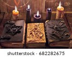 three magic books with burning... | Shutterstock . vector #682282675