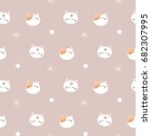 Stock vector seamless pattern of cute cartoon cat head design on pastel brown background 682307995