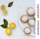 lemon cupcakes dusted with... | Shutterstock . vector #682322491