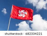 Hong Kong Flag Waving Over Blu...