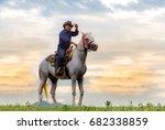 cowboy on horseback . ranch | Shutterstock . vector #682338859