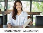 asian woman open menu for... | Shutterstock . vector #682350754
