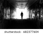 A Man In A Tunnel With Graffiti ...