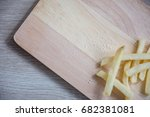 tasty french fries  on wooden... | Shutterstock . vector #682381081