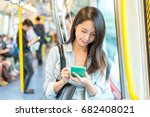 woman use of cellphone inside... | Shutterstock . vector #682408021