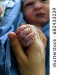 newborn baby holding mother's... | Shutterstock . vector #682433239
