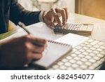 businessman with calculator... | Shutterstock . vector #682454077