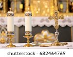 Small photo of Golden cross on the altar with candles and empty place for text