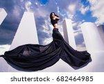 woman blackdress flying silk... | Shutterstock . vector #682464985